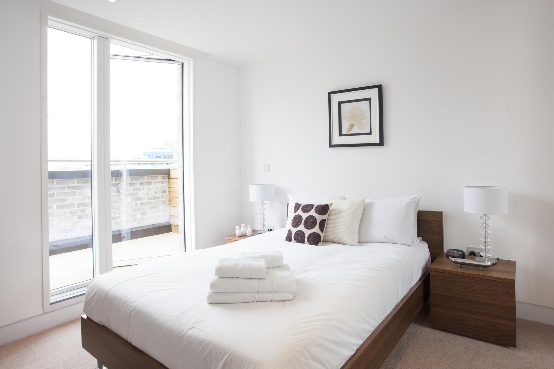 Bright bedroom at London Square Apartments - Citybase Apartments