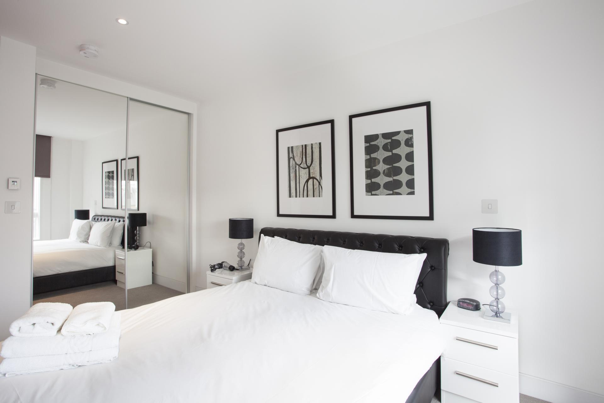 Stylish bedroom at London Square Apartments - Citybase Apartments