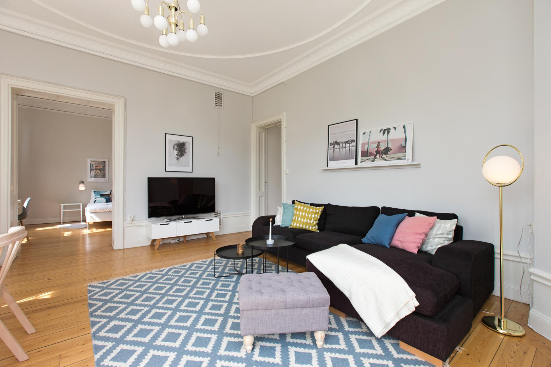 Black sofa at Vasastan Apartments, Vasastan, Stockholm - Citybase Apartments