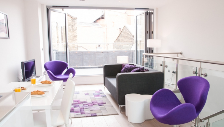Modern living area at Clarendon Chandos Place - Citybase Apartments