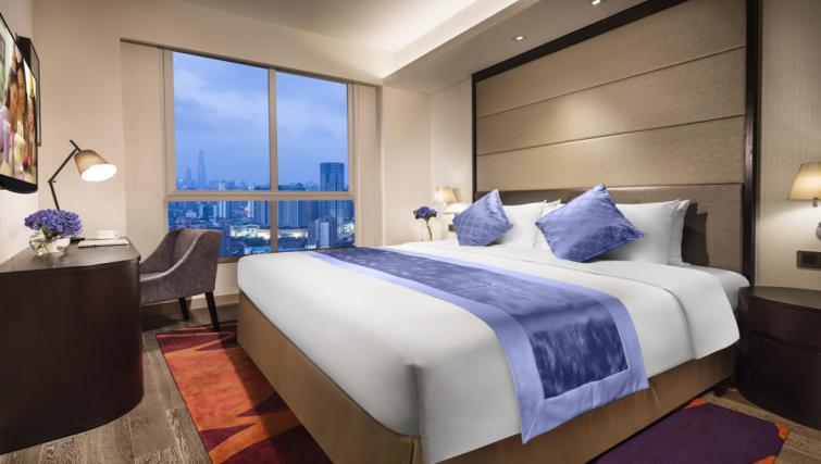 Tasteful bedroom in Somerset Xu Hui Apartments - Citybase Apartments