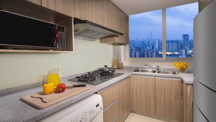 modern kitchen at Somerset Xu Hui Apartments - Citybase Apartments