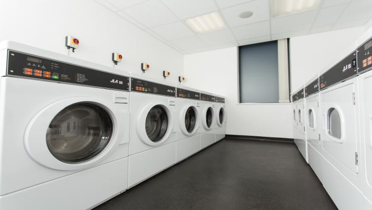 Laundry room in Staybridge Suites Birmingham - Citybase Apartments
