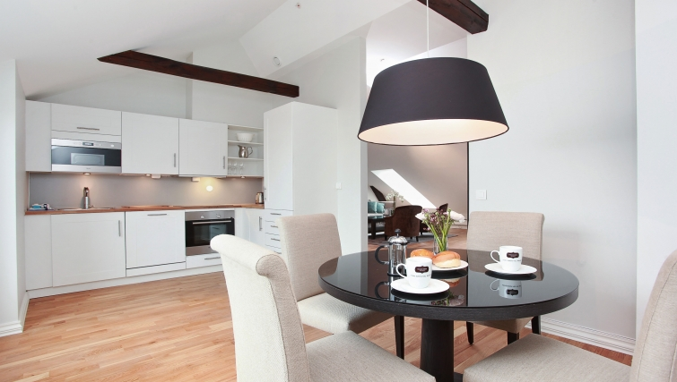 Elegant dining area in Frydenlundgata Apartments - Citybase Apartments