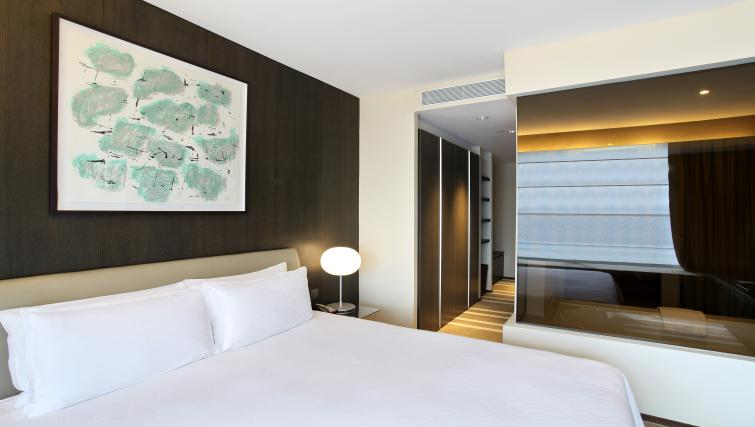 Bed at Pan Pacific Serviced Suites Orchard, Singapore - Citybase Apartments