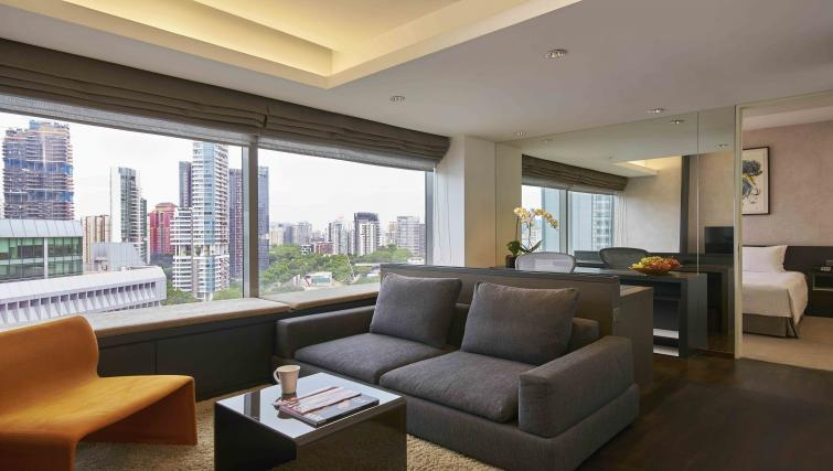 Bright living area at Pan Pacific Serviced Suites Orchard, Singapore - Citybase Apartments