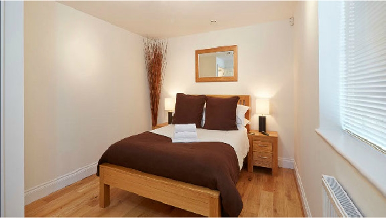 Stylish bedroom in Hendry Court Apartments - Citybase Apartments