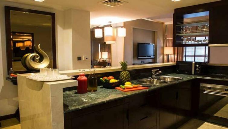 Compact kitchen at Dusit Thani Dubai Apartments - Citybase Apartments
