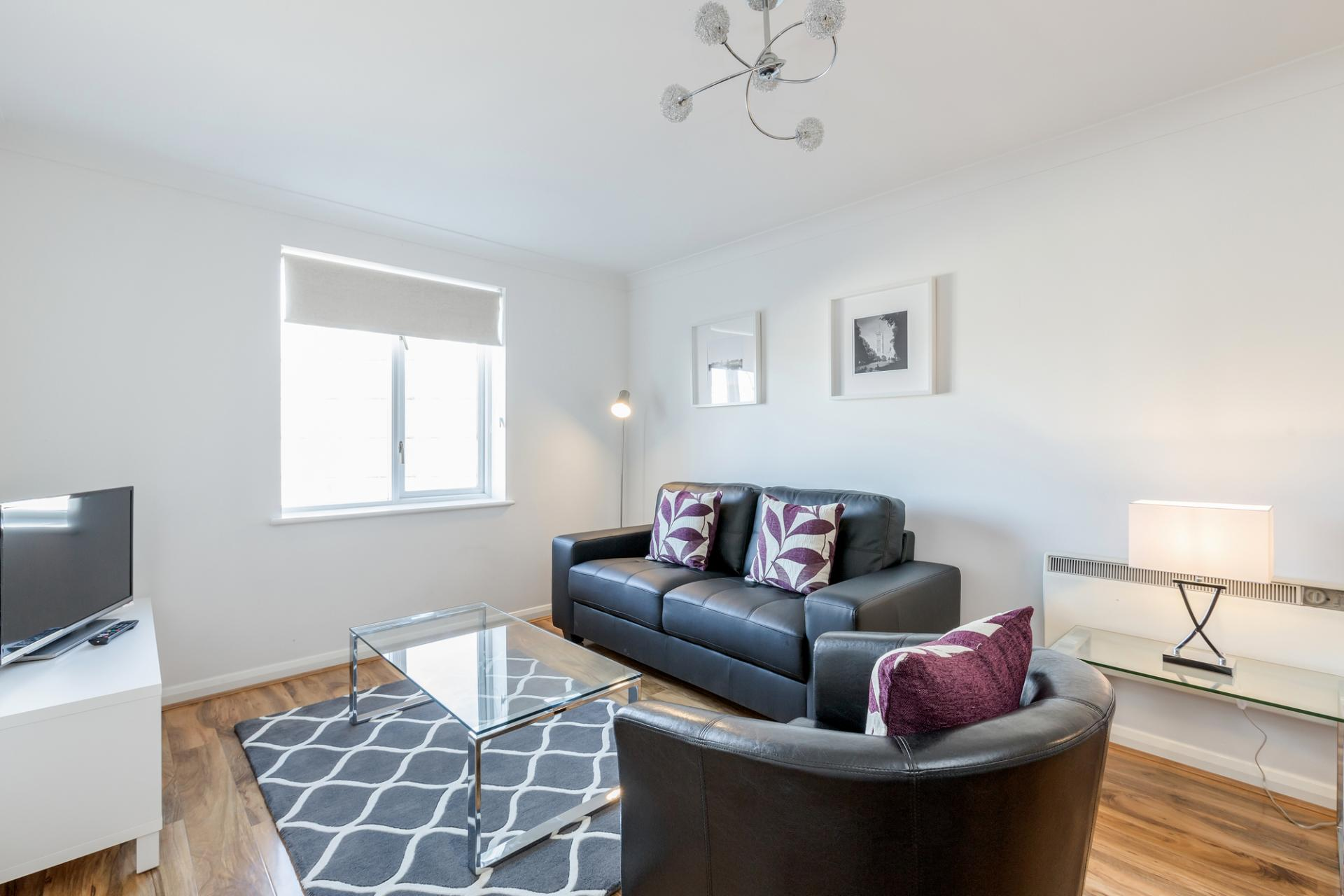 Living area at Regents Court, Kingston upon Thames, London - Citybase Apartments