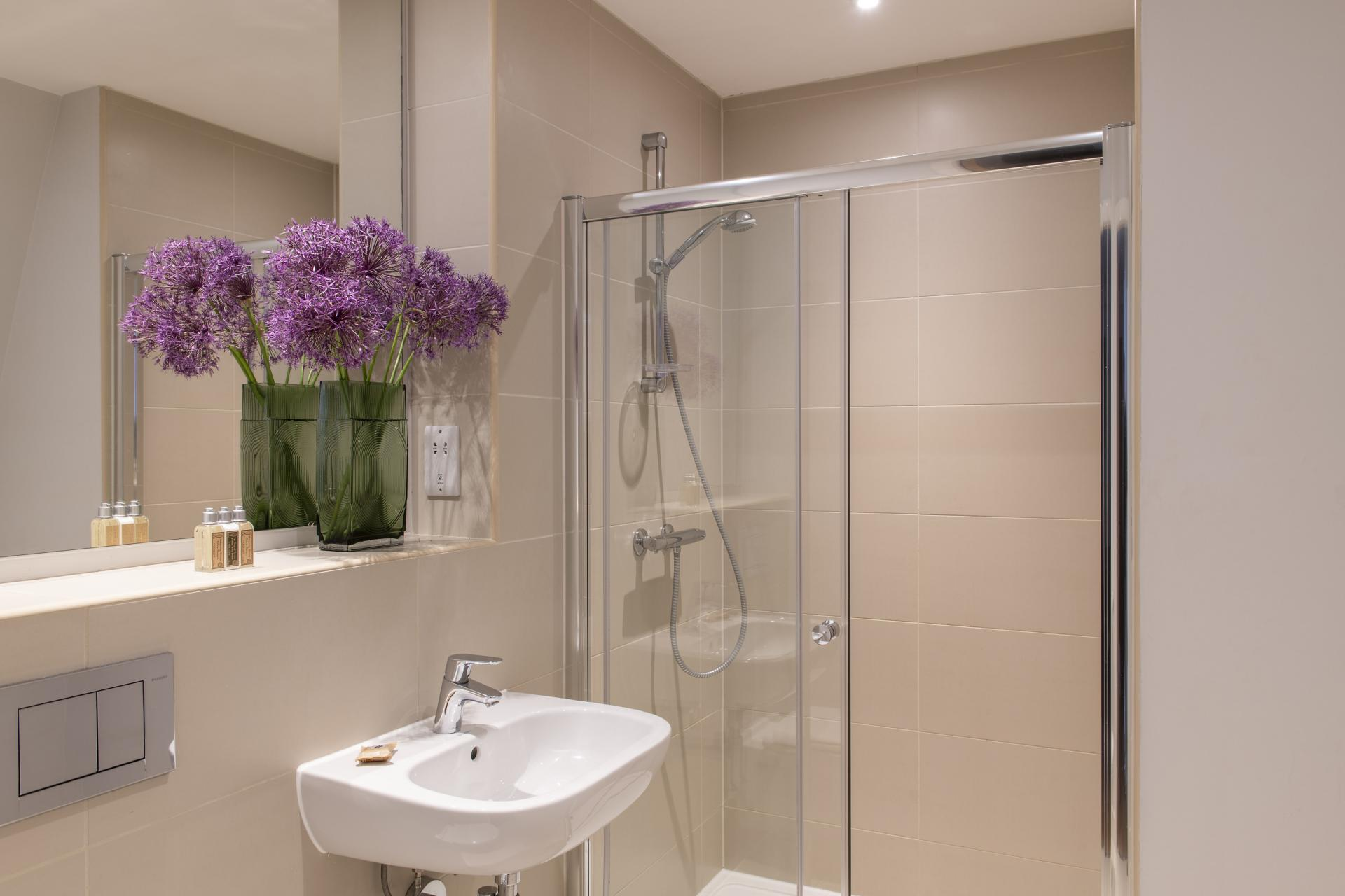 Sink and shower at Cove Minshull Street, Piccadilly, Manchester - Citybase Apartments