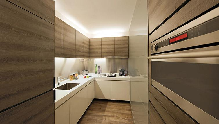 Kitchen at Pan Pacific Serviced Suites Beach Road, Singapore - Citybase Apartments