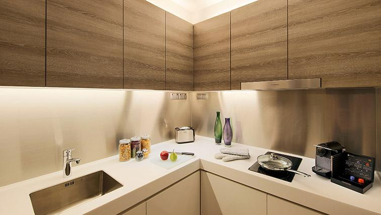 Equipped kitchen at Pan Pacific Serviced Suites Beach Road, Singapore - Citybase Apartments