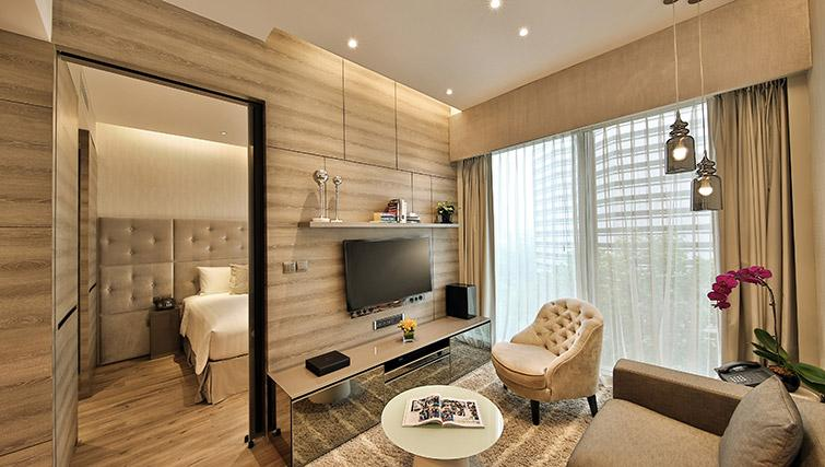 Living area at Pan Pacific Serviced Suites Beach Road, Singapore - Citybase Apartments