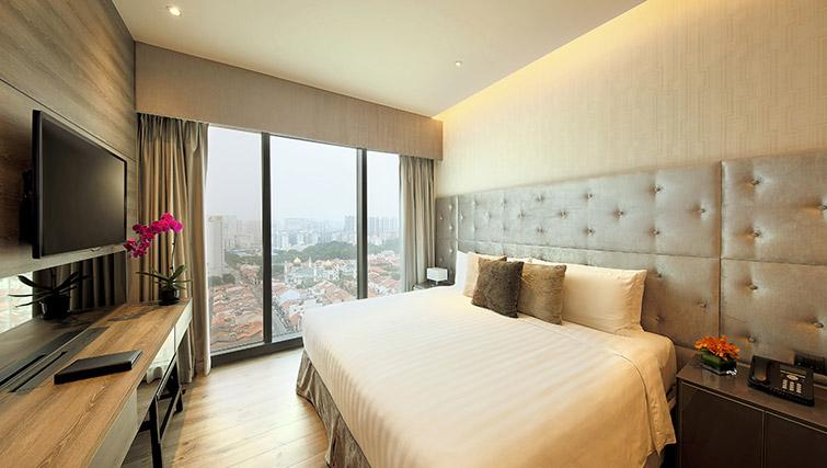 Bed at Pan Pacific Serviced Suites Beach Road, Singapore - Citybase Apartments