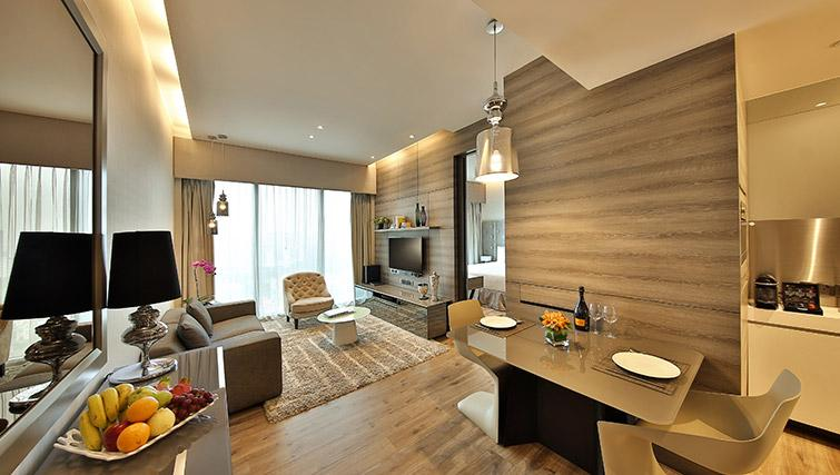 Living room at Pan Pacific Serviced Suites Beach Road, Singapore - Citybase Apartments