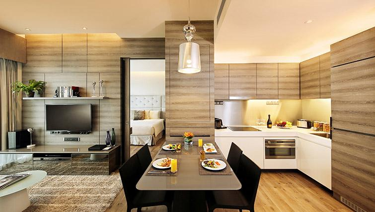 Dining area at Pan Pacific Serviced Suites Beach Road, Singapore - Citybase Apartments