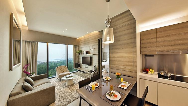 Open plan living area at Pan Pacific Serviced Suites Beach Road, Singapore - Citybase Apartments