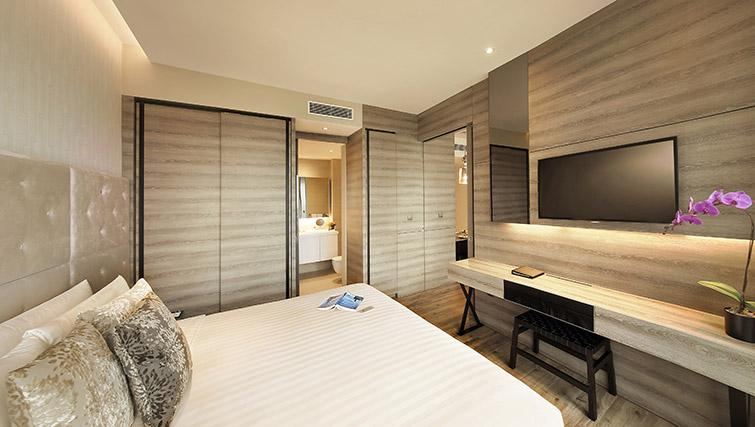 Cosy bedroom at Pan Pacific Serviced Suites Beach Road, Singapore - Citybase Apartments