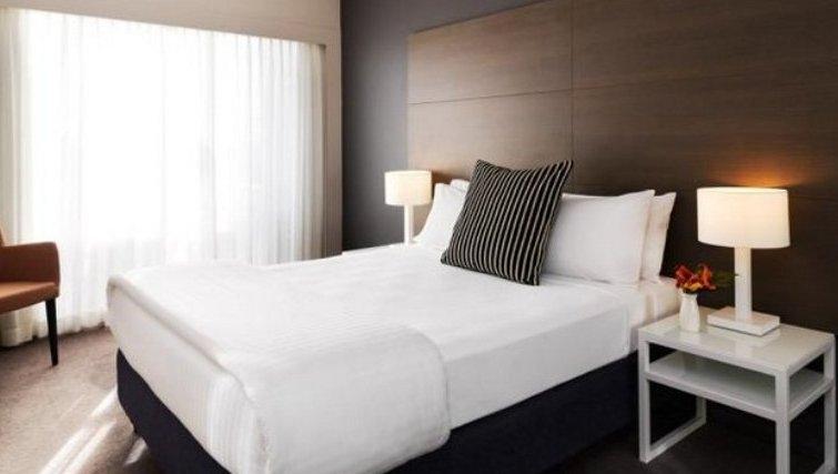 Elegant bedroom in Adina Apartment Hotel Sydney, Surry Hills - Citybase Apartments