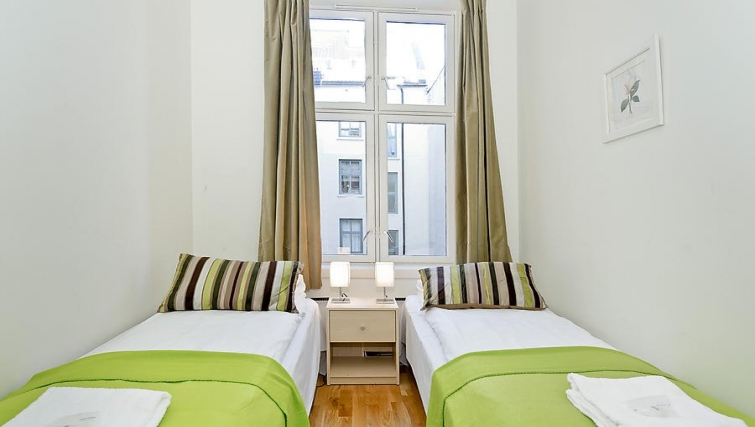 Bedroom with twin beds in Sven Bruns Gate Apartments - Citybase Apartments