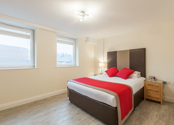 Spacious bedroom at Central Point Apartments - Citybase Apartments