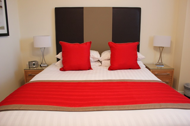 Comfortable bed at Central Point Apartments - Citybase Apartments