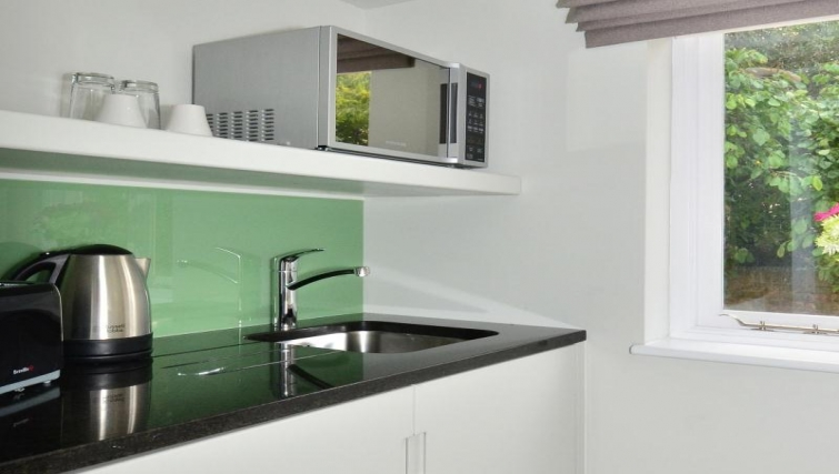 Modern kitchen in a  studio at So Arch Way Apartments - Citybase Apartments