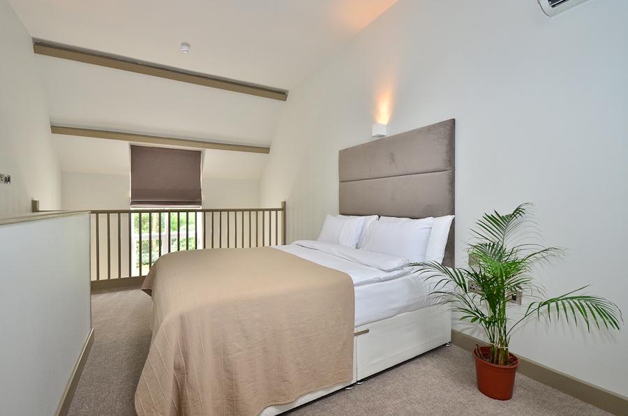 Upstairs bedroom at So Arch Way Apartments - Citybase Apartments