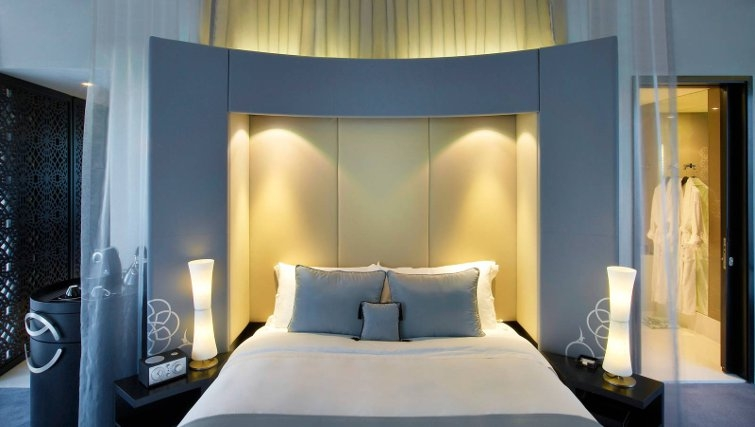 Warm bedroom in W Doha Hotel & Residences - Citybase Apartments