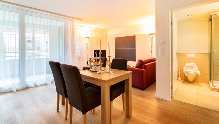 Living/dining area at Freigut 26 Apartments - Citybase Apartments