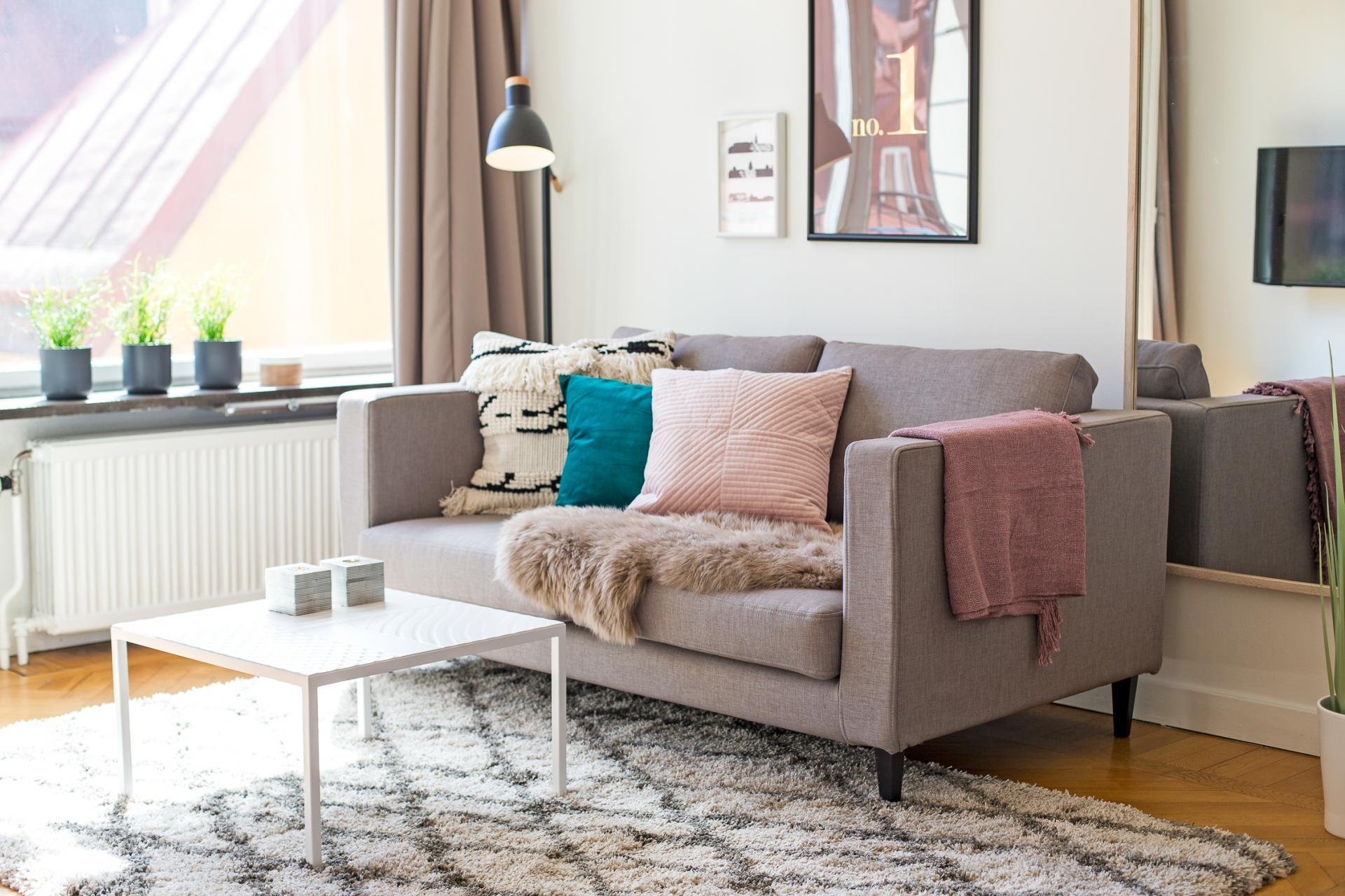 Sofa at Grevgatan Apartments - Citybase Apartments