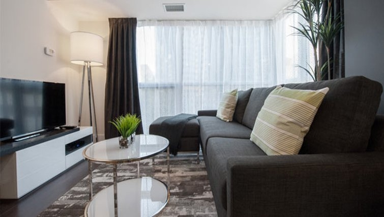 Contemporary living area in 300 Front Street West Delsuites - Citybase Apartments