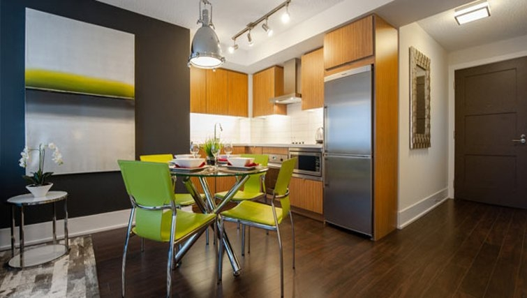 Vibrant dining area in 300 Front Street West Delsuites - Citybase Apartments