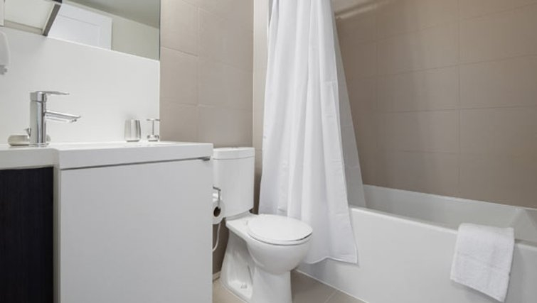 Immaculate bathroom in 300 Front Street West Delsuites - Citybase Apartments
