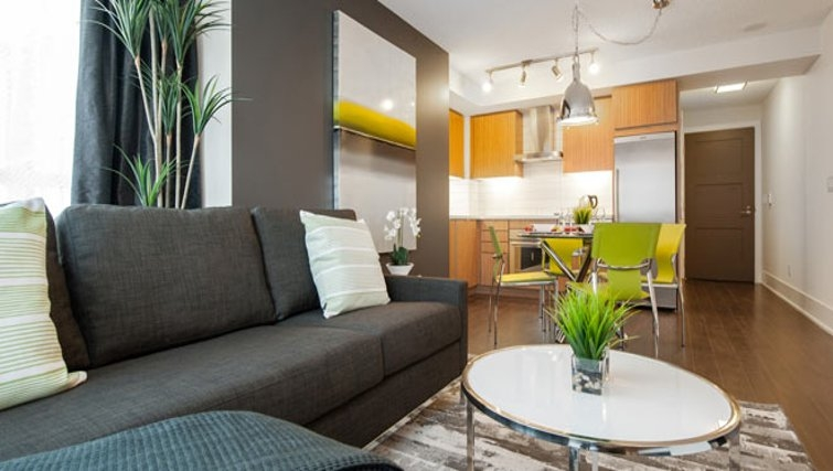 Attractive living area in 300 Front Street West Delsuites - Citybase Apartments