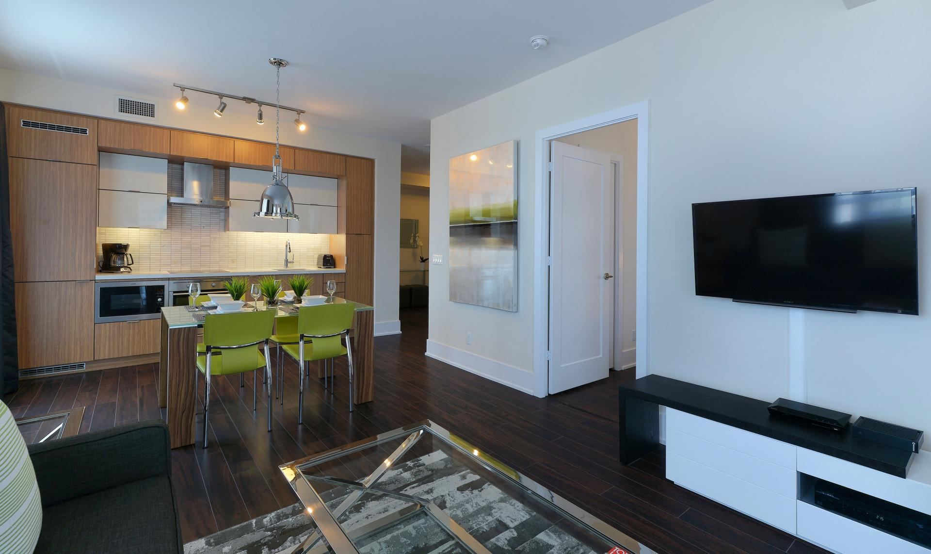 Open-plan living area at 300 Front Street West Delsuites - Citybase Apartments