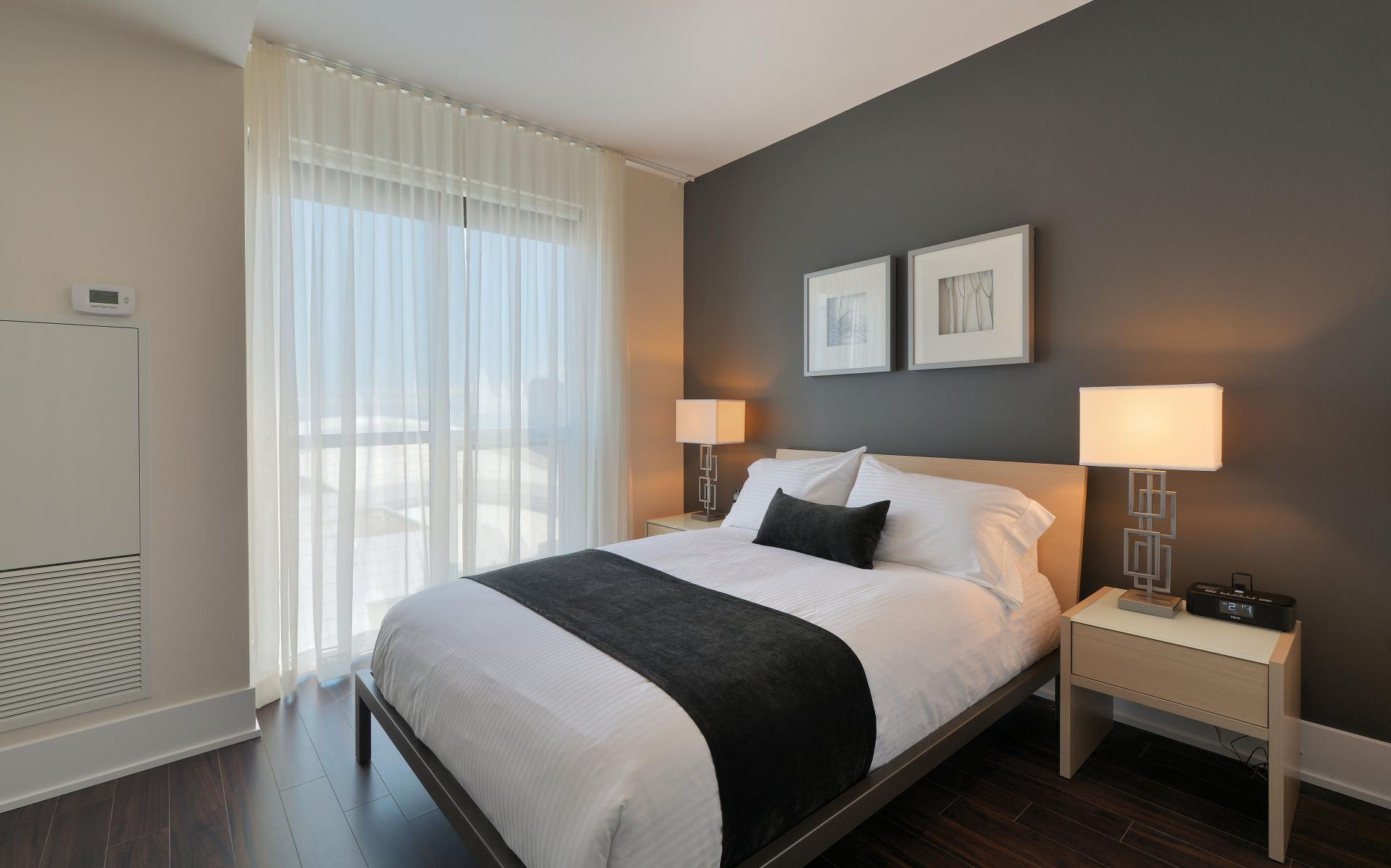 Cosy bedroom at 300 Front Street West Delsuites - Citybase Apartments