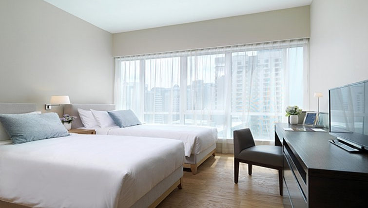 Bright bedroom in Lanson Place Bukit Ceylon Serviced Residences - Citybase Apartments
