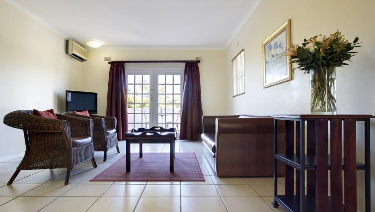 Living area at Best Western Cape Suites Hotel - Citybase Apartments