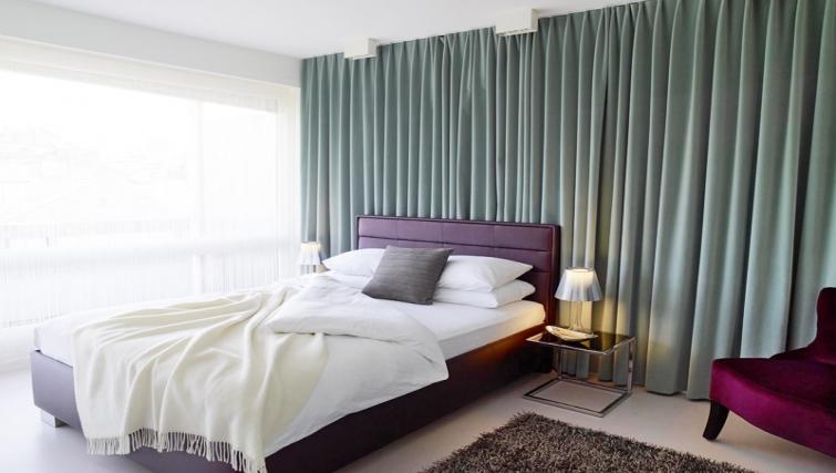 Bright bedroom at Caroline Apartments - Citybase Apartments