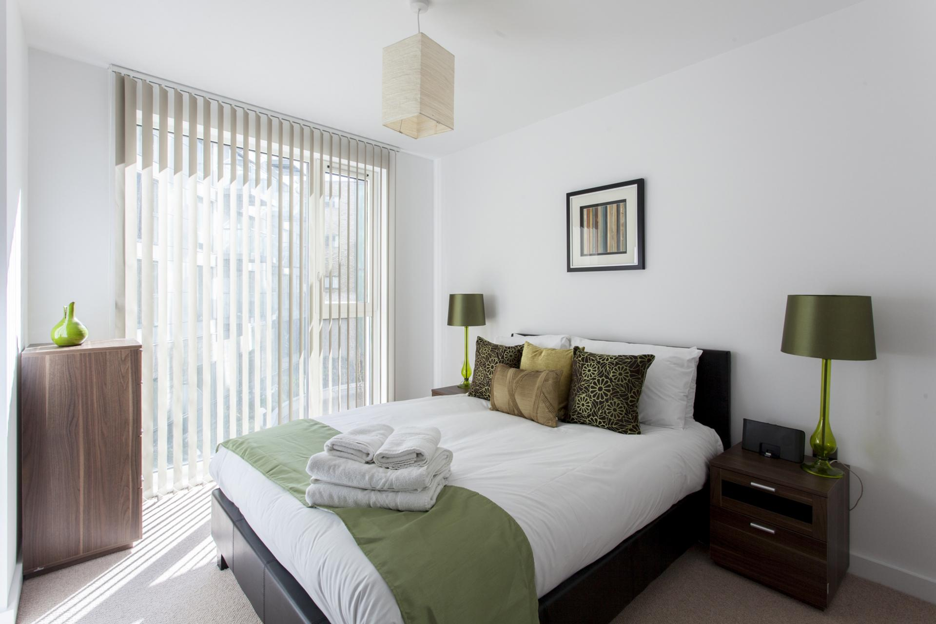 Bright bedroom at Avante-Garde Apartments - Citybase Apartments