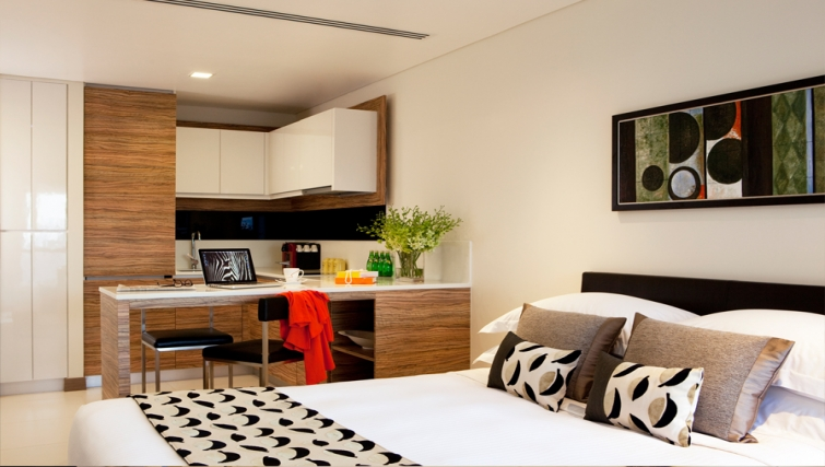Open plan kitchen at studio apartment in the 8 on Claymore Apartments, Singapore - Citybase Apartments