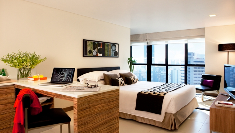 Living room at studio apartment in the 8 on Claymore Apartments, Singapore - Citybase Apartments