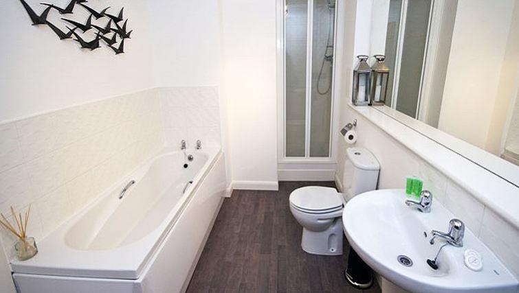 Bathroom at Beach Apartments - Citybase Apartments