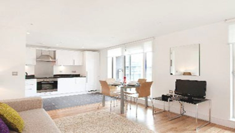 Open-plan living and kitchen area at Indescon Square Apartments - Citybase Apartments