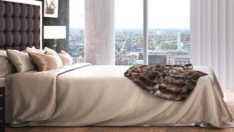 Stylish bedroom at One Commercial Street Apartments - Citybase Apartments