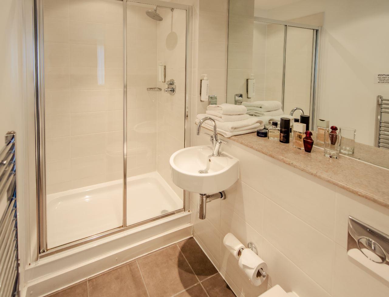 Shower at Premier Suites Manchester - Citybase Apartments
