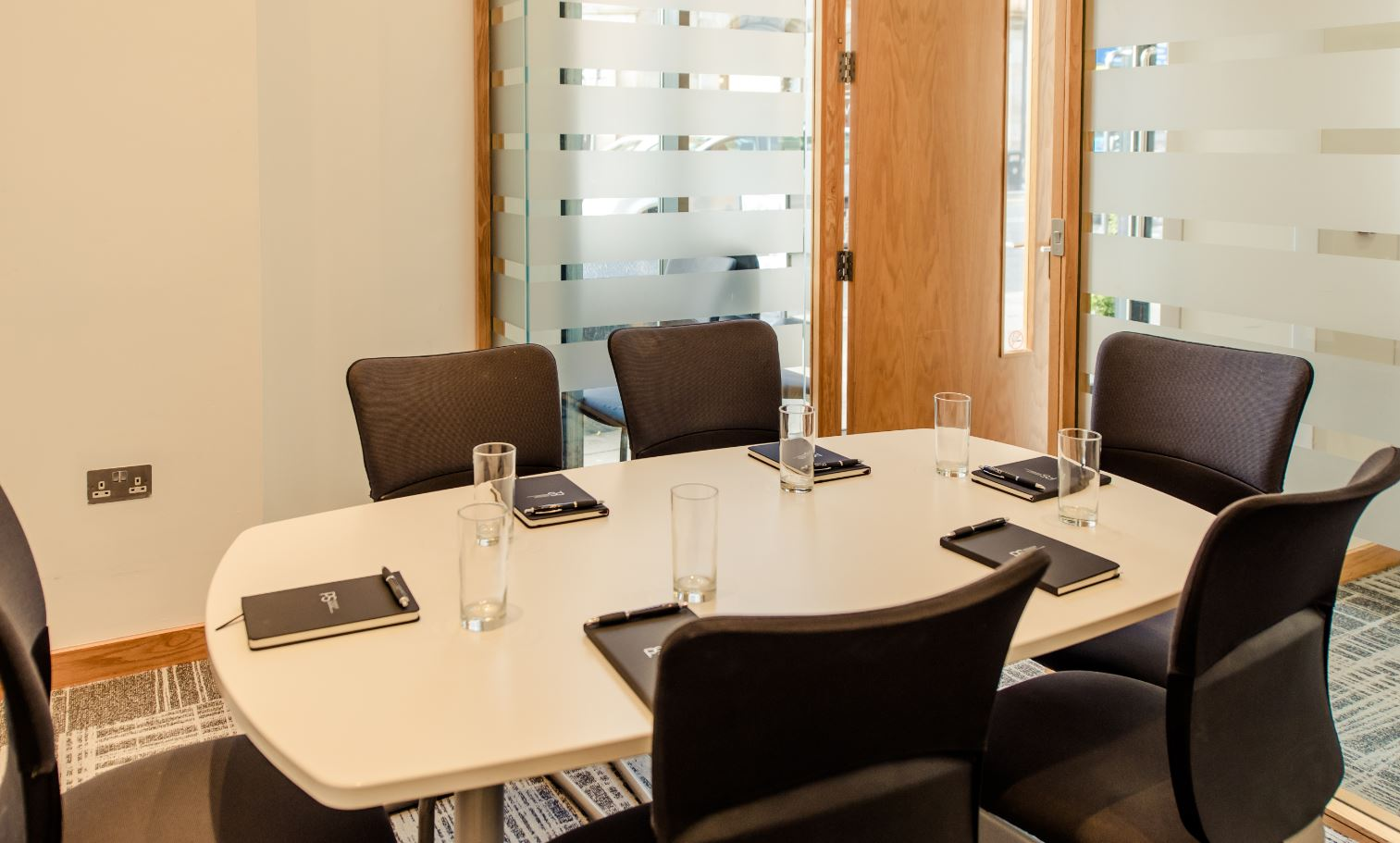 Conference room at Premier Suites Manchester - Citybase Apartments