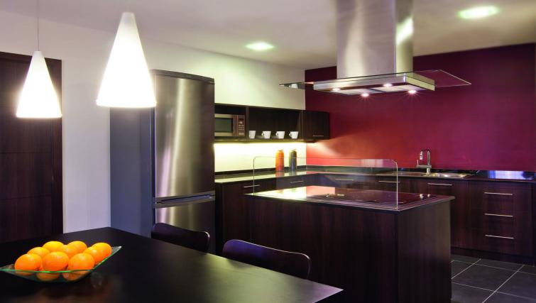 Kitchen at Moevenpick Al Mamzar Apartments - Citybase Apartments