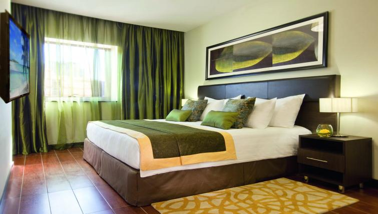 Bedroom at Moevenpick Al Mamzar Apartments - Citybase Apartments